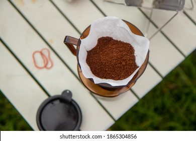 Coffee powder on white paper and coffee bowl.