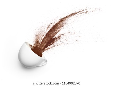 Coffee powder spilled out from cup over white background