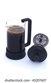 a coffee press with hot coffee inside