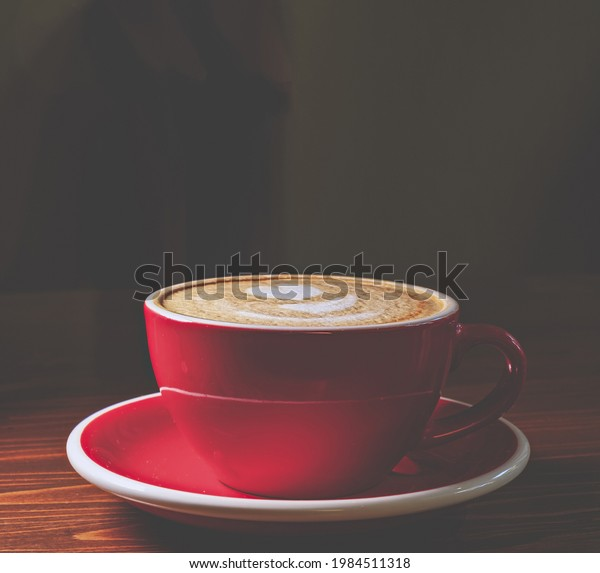 coffee-red-cup-on-desk-600w-1984511318.j