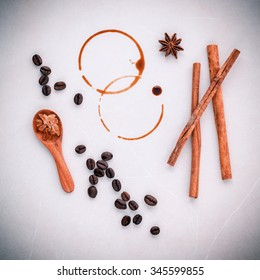 Coffee rings and Coffee beans,star anise ,cinnamon and brown sugar setup on table for menu design.
