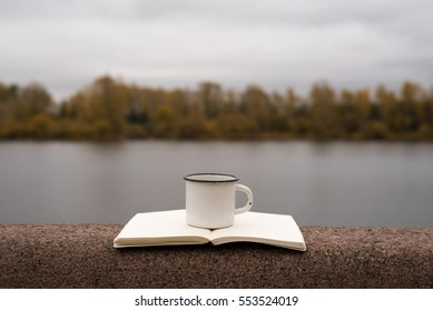 Coffee, river and blank pages