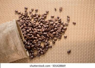 coffee sacks, bag of coffee beans on a Wood weave background