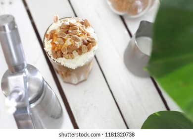 Coffee with salty caramel and nuts.