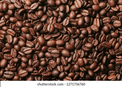 Coffee seeds pattern texture. Black morning coffee beans artistic light studio background