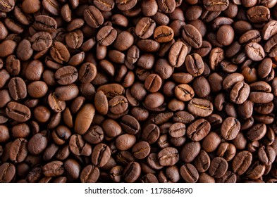 Coffee seeds, texture, top view, with hard side light and high contrast
