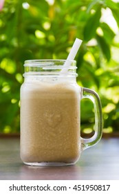 Coffee shake for breakfast. Cold, refreshing drink dessert in nature