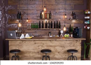 Coffee shop bar counter with wine bottles. Modern design. Vintage atmosphere. - Shutterstock ID 1342929293