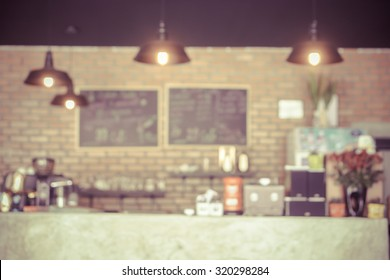 coffee shop blur background with bokeh image,in vintage effect.