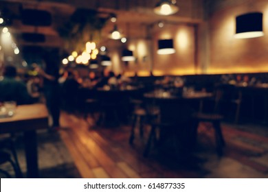 Coffee shop blur background with bokeh light with vintage filter