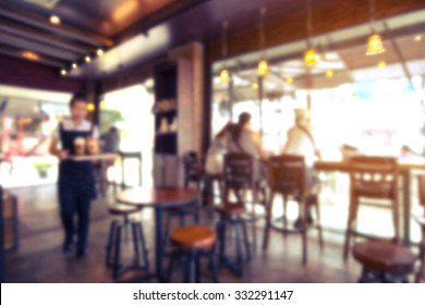 Coffee shop - cafe blurred with bokeh background