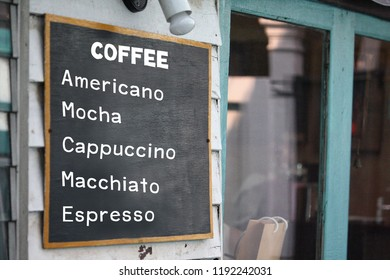 coffee shop menu.on Black label.The letter is written as Americano ,Mocha , Cappuccino , Macchiato , Espresso.