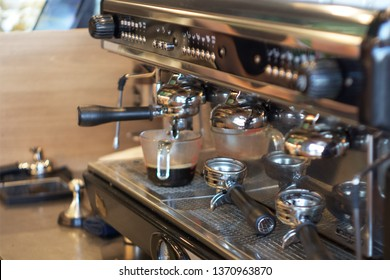 coffee shop, people are making coffee by coffee machine