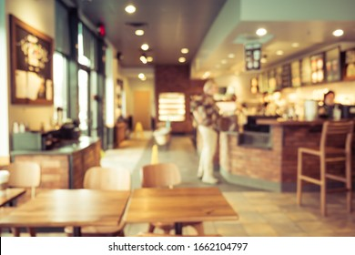 Coffee shop and people sit on table. Blur background image.