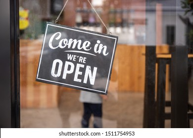 Coffee shop sign. come in we're open.