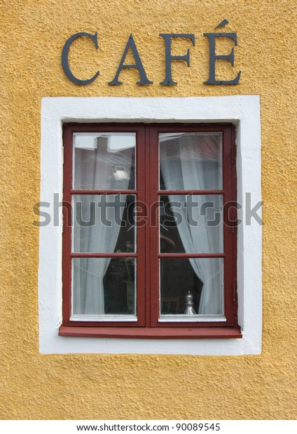 Coffee shop window with cafe sign.