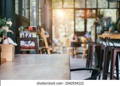 coffee shop and wooden table space in morning light