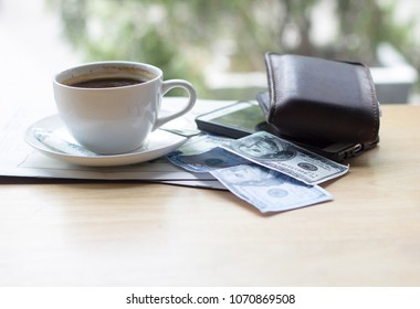 coffee , smart phone and walet on table