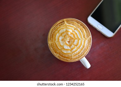 Coffee and Smartphone (Mobile phone) on wood table , lifestyle concept.