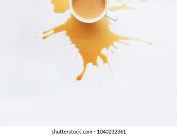 coffee with Spilled coffee background.  Cut Coffee cup on a white background. Flat Lay. Morning. Top view. Copy Space.