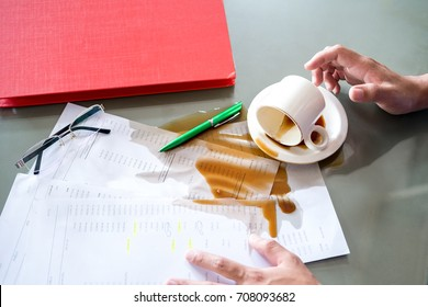 Coffee spilled on the desk while working.