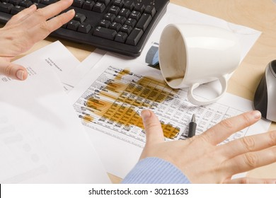 coffee spilled on important documents at a desk