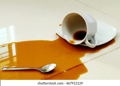 Coffee spilled on the white floor