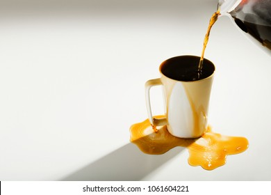 Coffee spilling out of a cup
