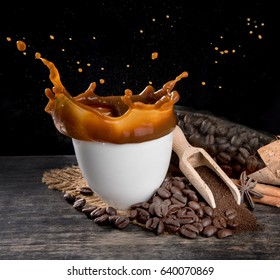 Coffee splash with coffee beans on table wood over dark background