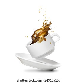 Coffee splash from a white cup. Isolated on white.