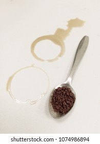 coffee stain and coffee powder in the  spoon