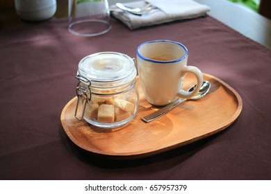 coffee and sugar with wood dish on the table