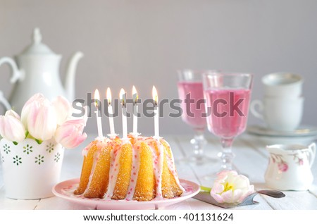 Coffee Table With Birthday Cake Candles And Tulips