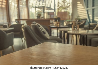 Coffee table and relaxing seats in pastel modern coffee shop (café restaurant, co-working space). Use for modern-style concept. For montage product display or design key visual layout. Copy space.