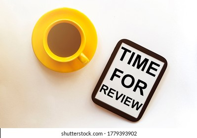 coffee and tablet with text Time For Review on the white background