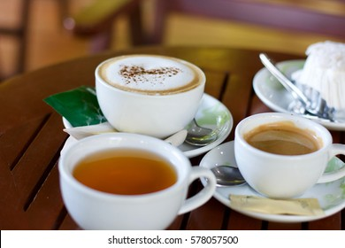 Coffee and tea in cup on table