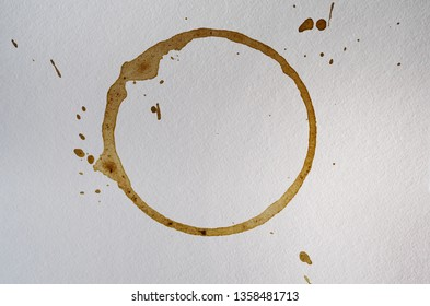 Coffee or tea cup stain on white paper texture background.