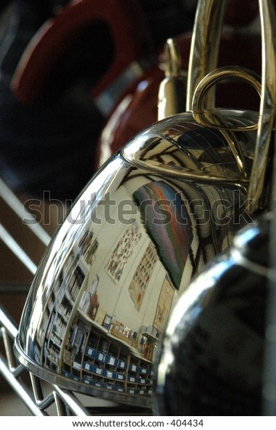 Coffee and tea shelf reflections on Spice store teapot