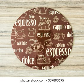 Coffee themed round tray on the wooden background. Offer of coffee.