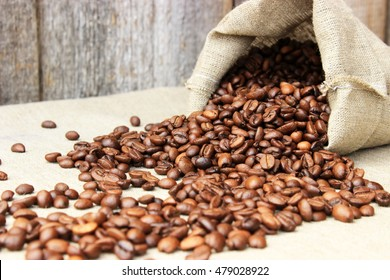 Coffee theme:parcel full of brown grains on textile linen background. Concept for cafe decoration