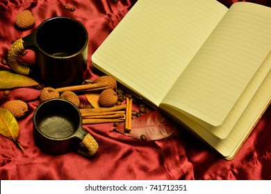 Coffee time. Coffee break. Indian style. Black Indian cups, white notebook, cinnamon, red silk.