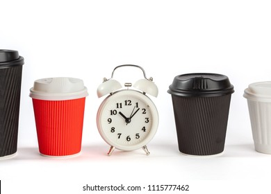 Coffee time concept with vintage alarm clock and disposable coffee cups on white background with copy space