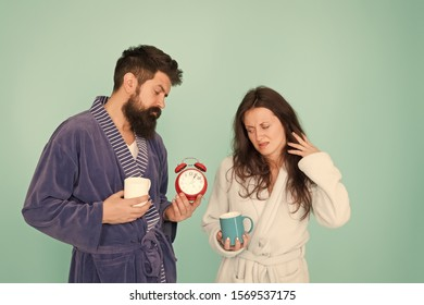 Its coffee time. Couple in bathrobes with mugs. Man with beard and sleepy woman enjoy morning coffee or tea. Guy in bath clothes hold tea coffee. Breakfast concept. Every morning begins with coffee.
