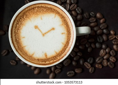 Coffee time ,Cup of fresh cappuccino with clock sign.