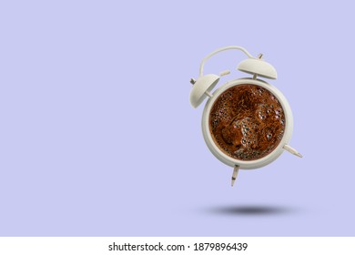 its coffee time, hot drink in the vintage clock isolated on pastel color background, creative idea