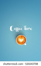coffee time word and cup of coffee latte art on color background