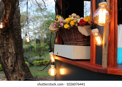Coffee trailer with roses in basket and merry lights