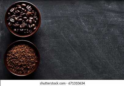 Coffee types: beans and instant in cups on dark board with copy space for text.