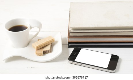 coffee and wafer with phone,stack of book
