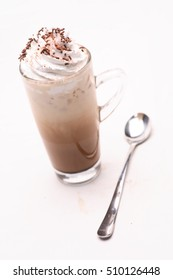 Coffee and whipped cream in clear glass.